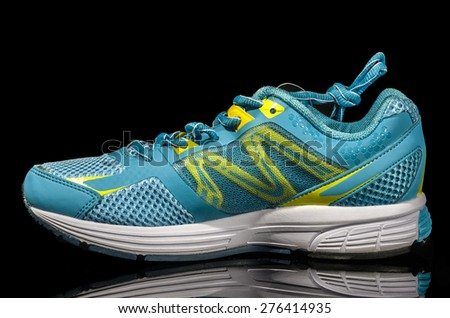 sports shoes isolated on black background - stock photo