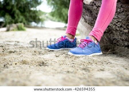 Sports shoes on the sand.