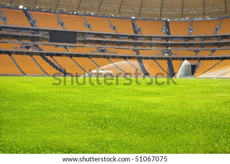 Sports stadium empty in off season having maintenance and watering done. - stock photo