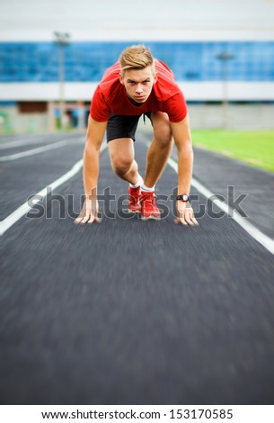 sports,start, beginning, path, concept, fighting, strength, success, one, leader, win, winner, sportman. athlete starts on the running track - stock photo