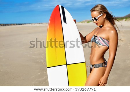 Sports. Surfing. Healthy Active Lifestyle. Summer Vacations. Athletic Surfer Woman, Girl With Sexy Body In Bikini With Surfboard Sunbathing On Sea Beach. Extreme Water Sport. Summertime Relaxation.