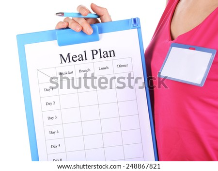 Sports trainer with meal program isolated on white - stock photo