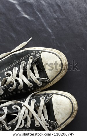 Sports trainers on tiled floor - stock photo
