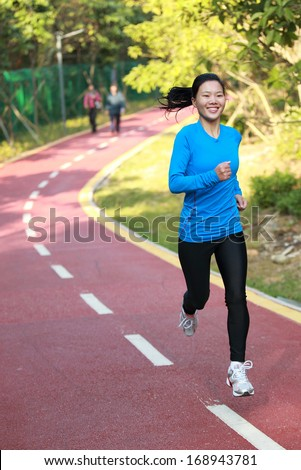 sports woman jogging outdoor in the morning  - stock photo
