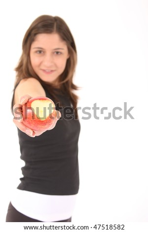 sports woman offers a red apple - stock photo