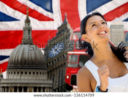 Sports woman running a marathon in London - stock photo