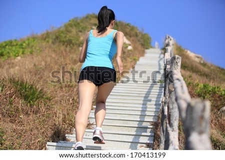 sports woman running/move up on mountain stairs