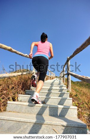 sports woman running/move up on mountain stairs  - stock photo