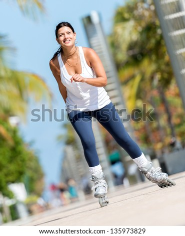 Sports woman skating outdoors keeping a healthy lifestyle - stock photo