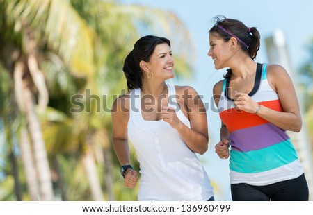 Sports women running outdoors getting ready for the summer - stock photo