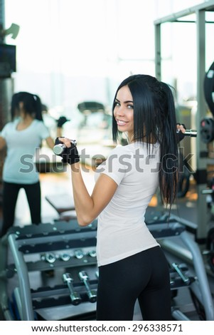 Sports young girl in fitness club
