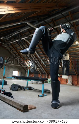 sportsman boxer in a makeshift home gym - stock photo