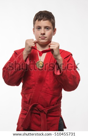 Sportsman boy brunette in a red kimono on a white background