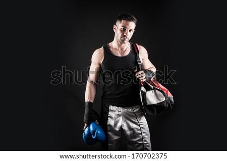 Sportsman kick boxer portrait after training against black background.  - stock photo
