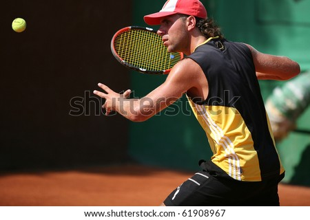 Sportsman plays tennis