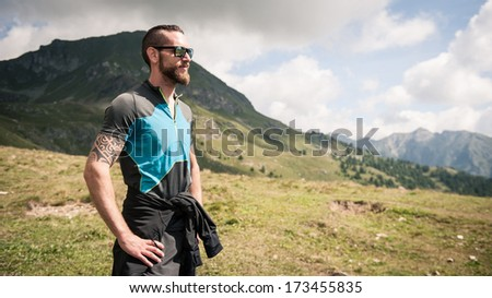 Sportsman portrait outdoor in the mountains. Alps, Italy.  - stock photo