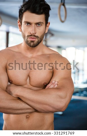 Sportsman with arms crossed