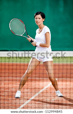 Sportswoman at the tennis court with racquet. Tournament - stock photo