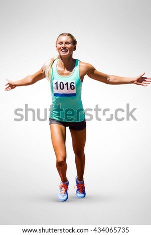 Sportswoman finishing her run on a white background - stock photo