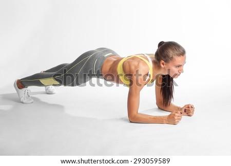 sportswoman planking isolated on white background - stock photo