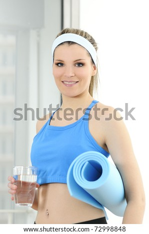sportve fitness beautiful woman with a glass of water - stock photo