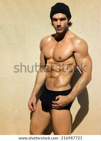 Sporty and healthy handsome muscular man - stock photo