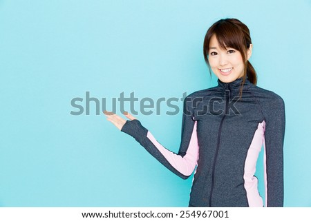 sporty attractive woman showing on blue background