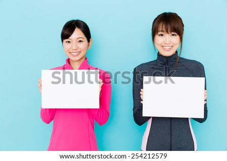 sporty attractive women on blue background - stock photo