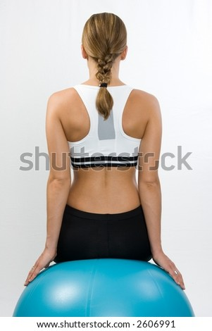 Sporty back on ball - stock photo