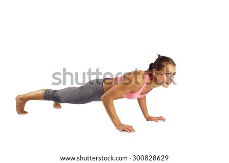 Sporty beautiful young woman in sportswear doing exercises  isolated white background  - stock photo