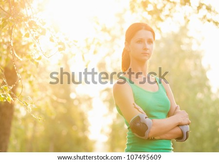 Sporty beauty girl in park - stock photo
