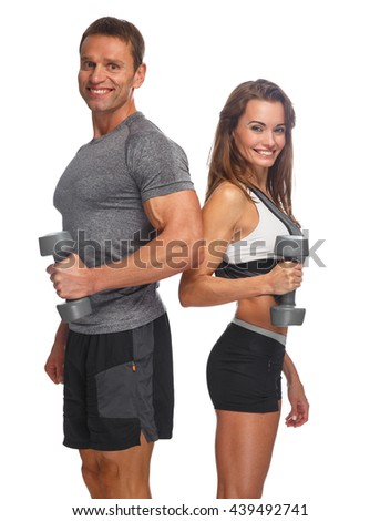 Sporty couple with dumbbells isolated on a white background. - stock photo
