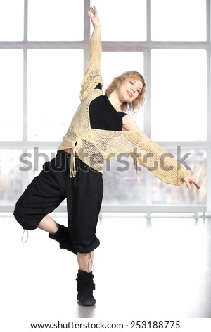 Sporty dancer woman in class exercising, warming up, dancing, doing fitness choreography  - stock photo