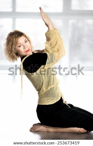 Sporty dancer woman in class working out, doing aerobics training, yoga practice, warming up - stock photo
