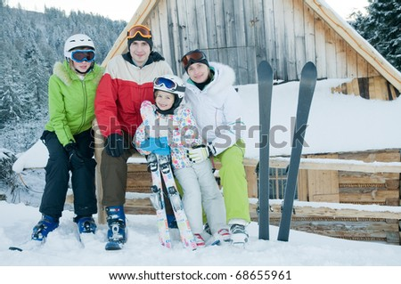 Sporty family on winter vacation - stock photo