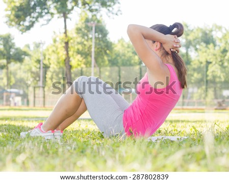 Sporty Fit Healthy Young Woman Practicing at beautiful summer day outdoor. - stock photo