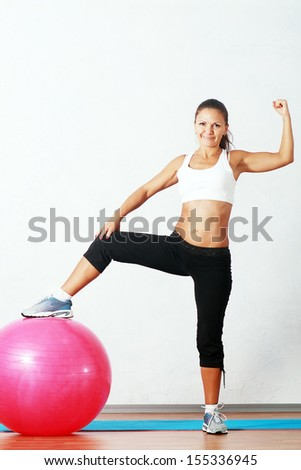 sporty fitness happy woman at the gym with a pilates ball - stock photo