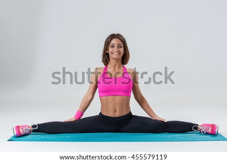 Sporty flexible girl doing stretching exercise - stock photo