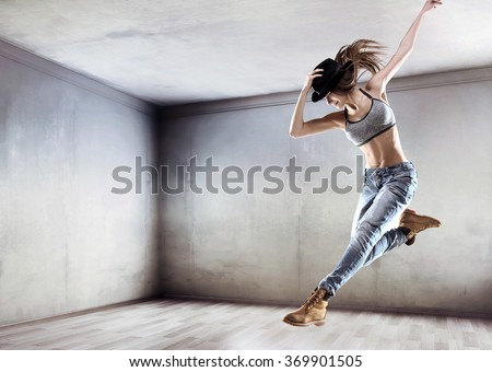 Sporty girl dancing hip-hop - stock photo