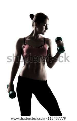 sporty girl doing exercise with dumbbells, silhouette studio shot over white background