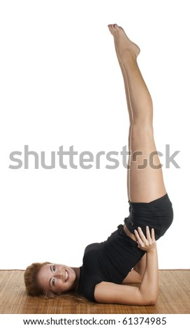 Sporty girl doing legs up exersise - stock photo