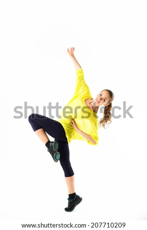 sporty girl doing stretching exercises - stock photo