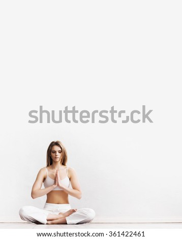 Sporty girl meditating. Yoga exercise. - stock photo