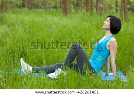Sporty girl resting in the wood