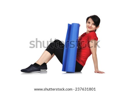 sporty girl sitting with mat for fitness - stock photo