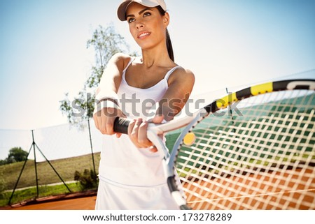 sporty girl tennis player with tennis racket - stock photo