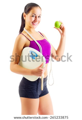 Sporty girl with apple and scales isolated - stock photo