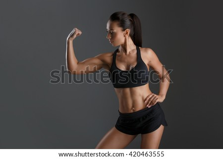 Sporty girl with muscles