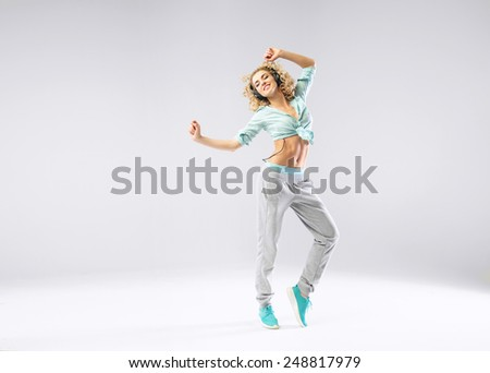 Sporty lady listening to the music - stock photo