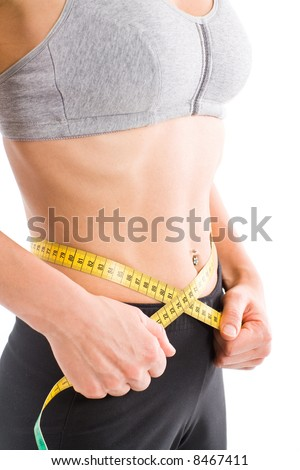 Sporty lean woman measuring waist. From bust to crotch. - stock photo